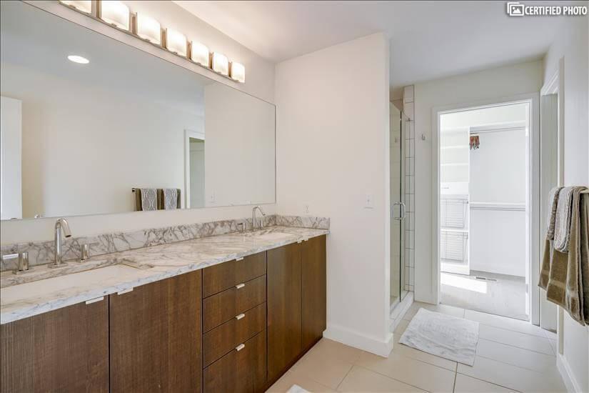 Bedroom 1 On Suite Bath w/Dual Sinks, Glass Shower & toilet