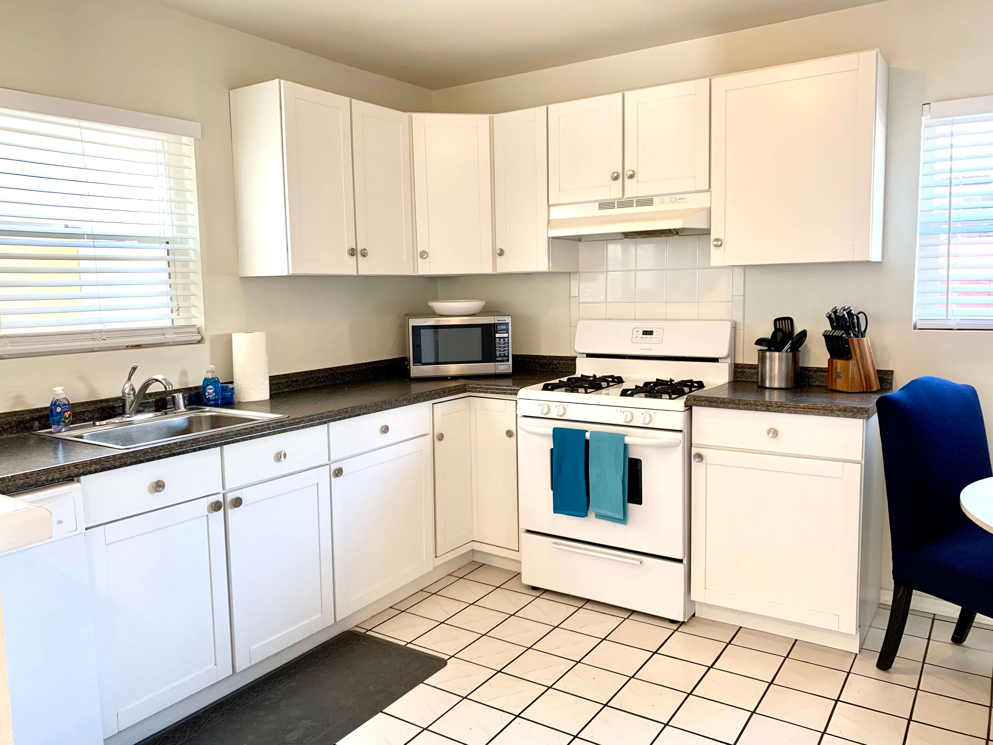 Full kitchen with modern appliances.