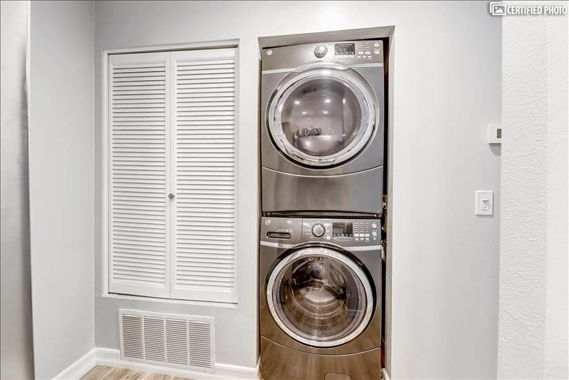 Large full size stainless steel washer and dryer.