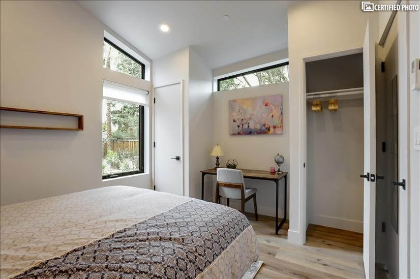 Bedroom with vaulted ceilings and plenty of l