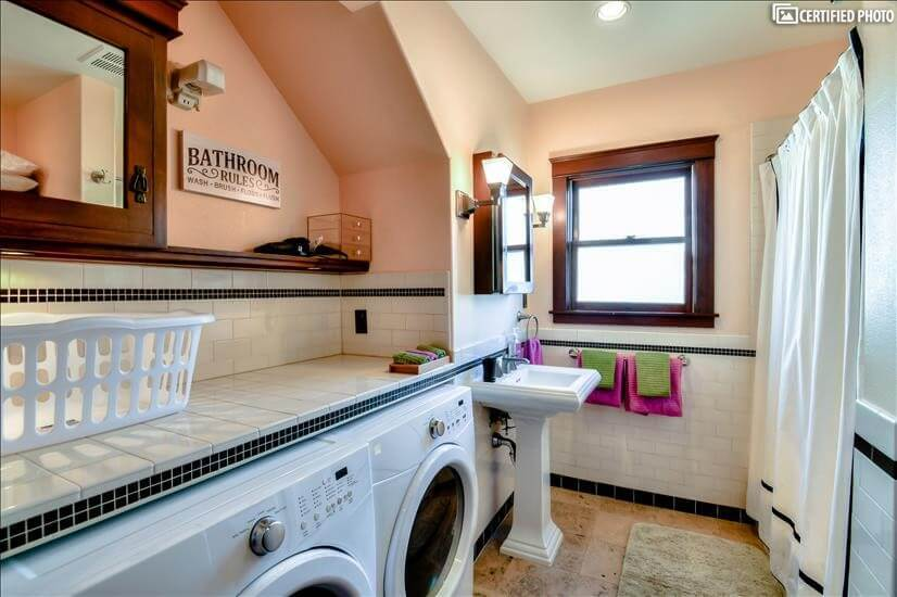 Upstairs full bathroom with washer and dryer