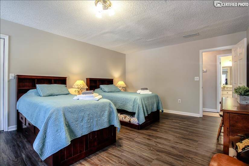 Middle bedroom on second floor with 4 twin beds.
