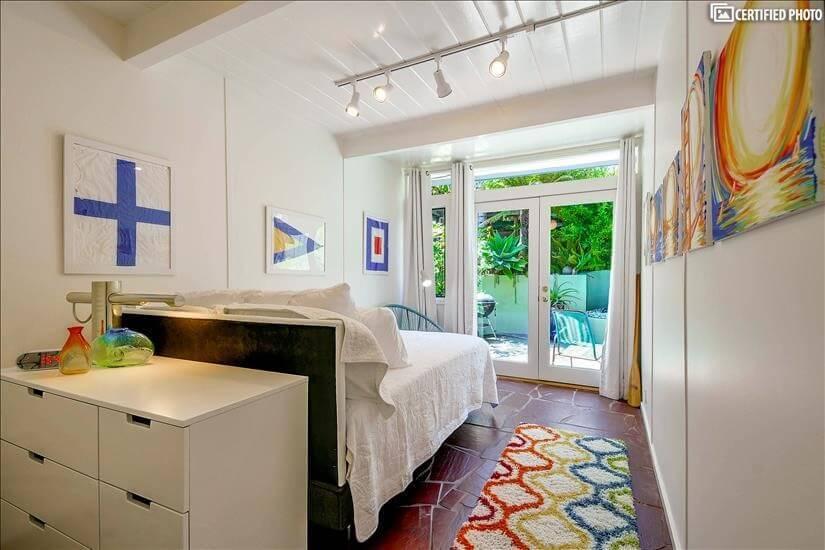 Second bedroom with garden views.