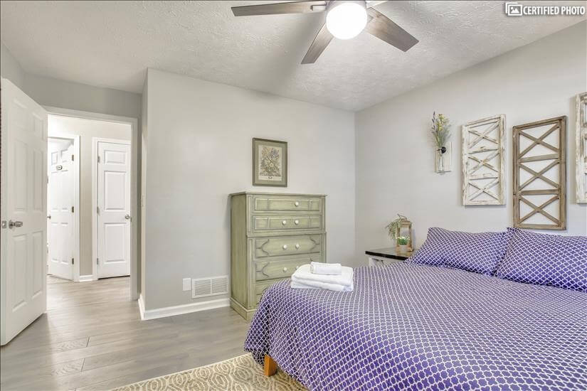 Dresser and nice decor adorn this room.