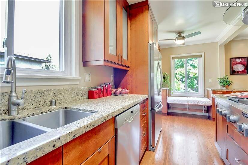Window above Stainless steel sink and dishwas