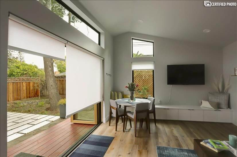 Wide folding door opens to a private patio