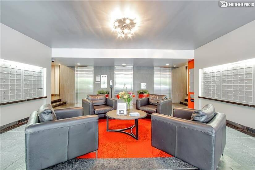 Lobby with plush leather chairs, mailboxes