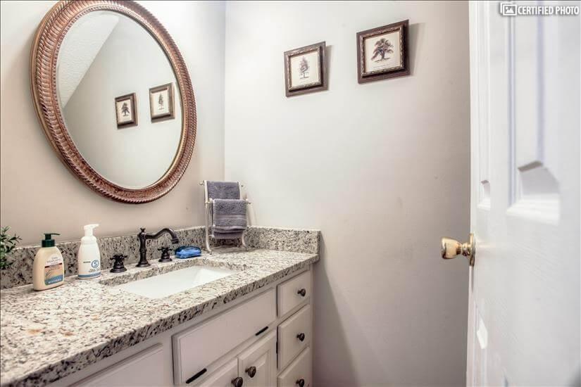 Powder Room/Half Bath in hall downstairs.