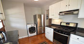Kitchen with large w/d combo, gas range, vent