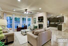 Open floor plan with double sided fireplace b...
