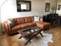 NEW sofa, coffee table and cowhide rug