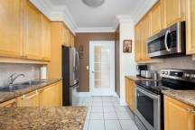 kitchen with granite counters and fully equip...