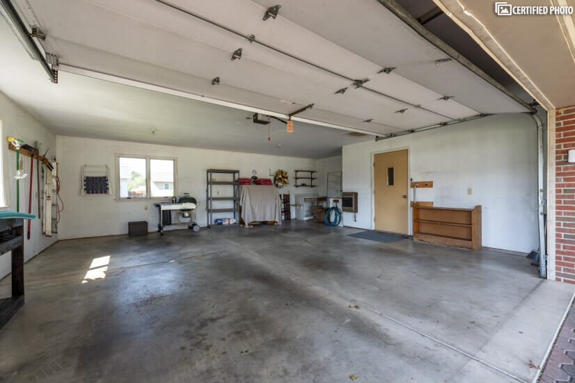 Large Garage with stationary tub and work area