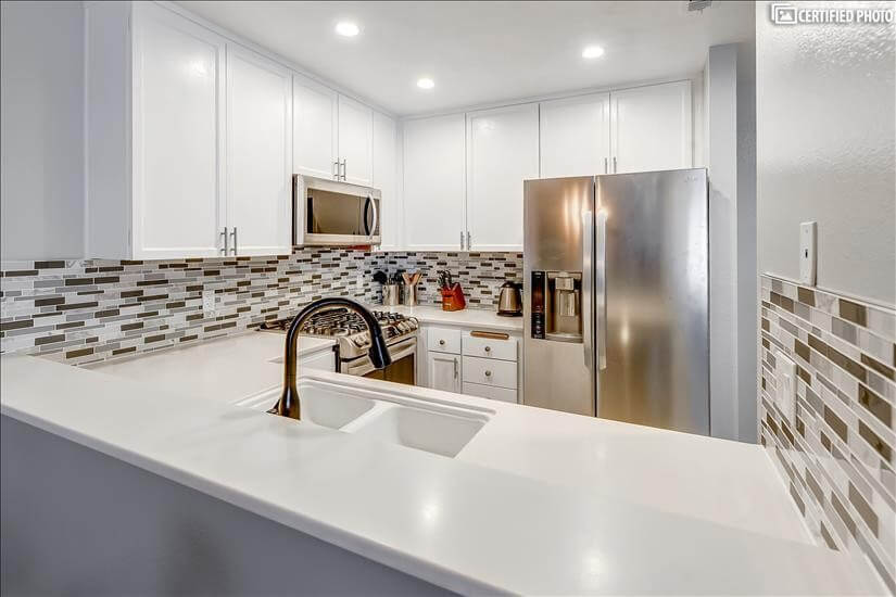 Gorgeous White Cabinets and Corian Countertops