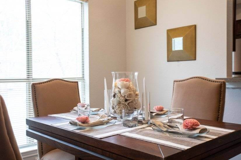 Enjoy this luxuriously set dinner table. Seating for 4!