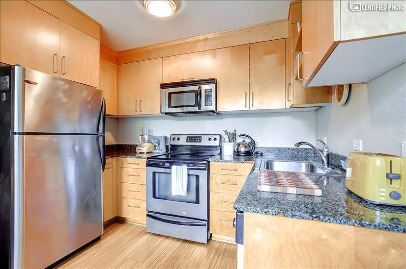 Granite counter tops and colorful small appliances