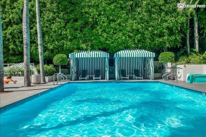 Relaxing pool, cabana lounge area