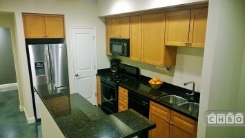 Kitchen with granite countertops and modern a