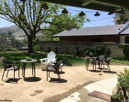 Lovely furnished and landscaped back yard is