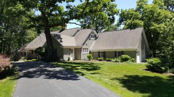 Secluded on 1.1 acres of lush greenery & huge
