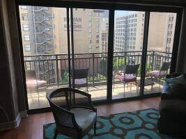 Spacious living room with access to balcony overlooking park