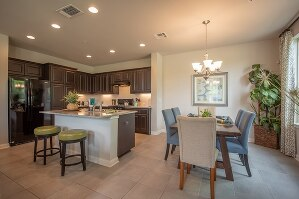 Kitchen is open to Dining and Living.