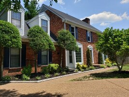 Beautiful landscaping, large driveway and 2 c