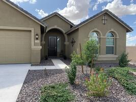 Home located on corner lot across from a gree