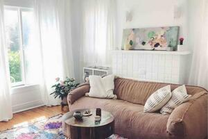 Living room with lots of natural lighting, handmade rugs