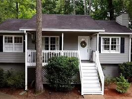 Beautiful corner lot with front sitting porch