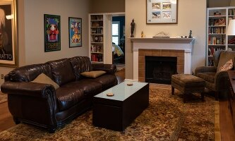 Living room, with wood-burning fireplace.