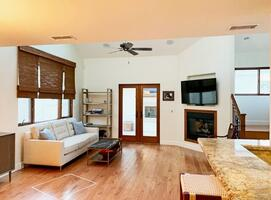 Living room with cable TV, gas fireplace