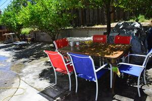 Rear yard w tavles and chairs