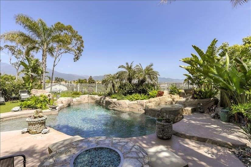 Backyard pool and jacuzzi with view of city a