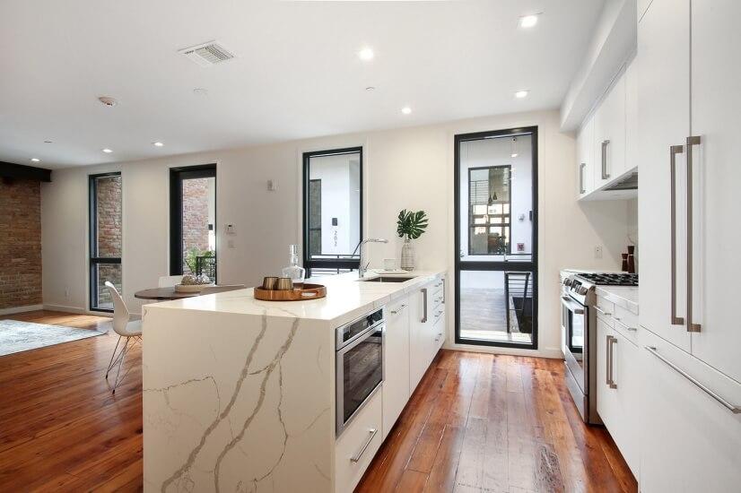 Open concept kitchen with Calacatta Quartz co