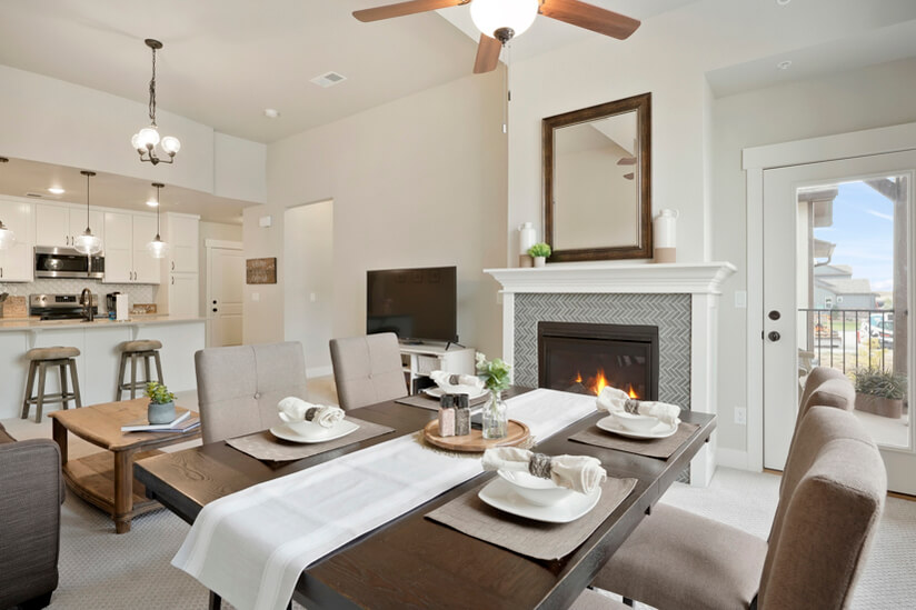 Open floorplan with fireplace and mountain view from patio